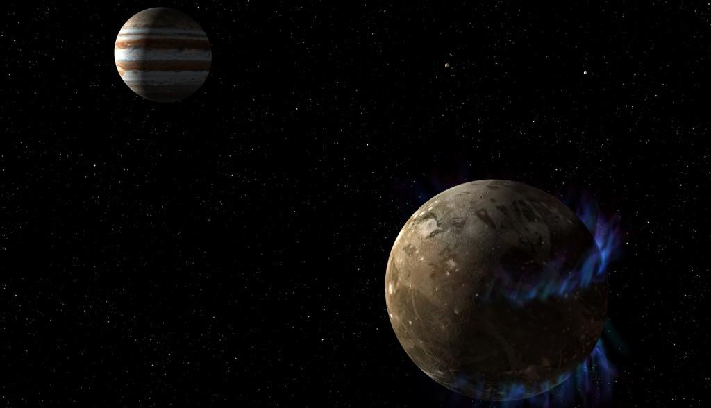 Illustrasjon Ganymedes med polarlys. Jupiter i bakgrunnen. Klikk for større versjon. Illustrasjon: NASA, ESA, G. Bacon (STScI)