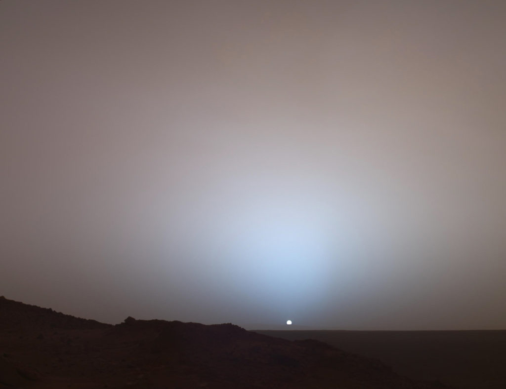On May 19th, 2005, NASA's Mars Exploration Rover Spirit captured this stunning view as the Sun sank below the rim of Gusev crater on Mars. (Image Credit: NASA/JPL-Caltech/Texas A&M/Cornell)